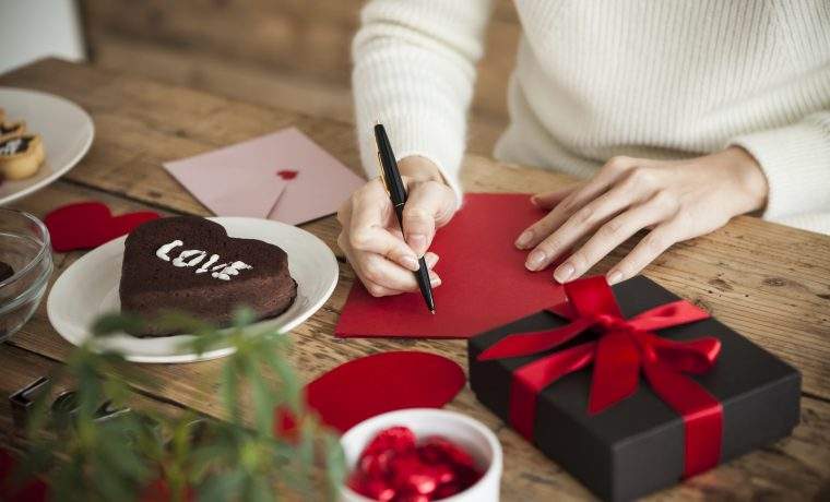woman is writing a message of love